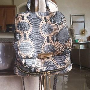 Aldo animal print snake backpack gold